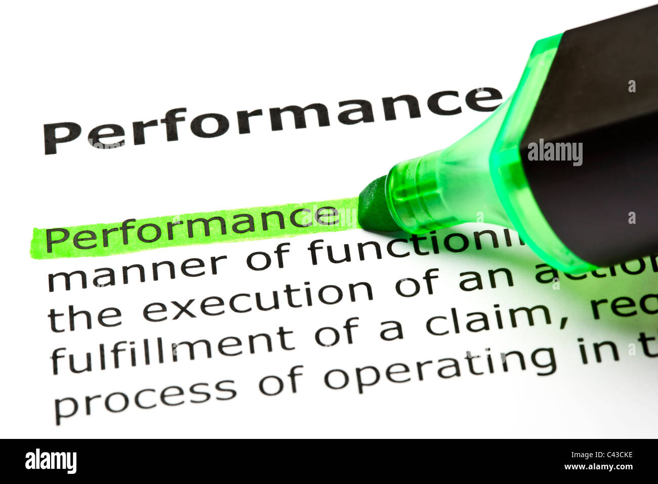 The word 'Performance' highlighted in green with felt tip pen - Stock Image