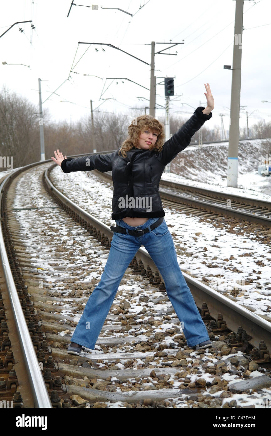 The girl on rails in the winter, Moscow, Russia - Stock Image