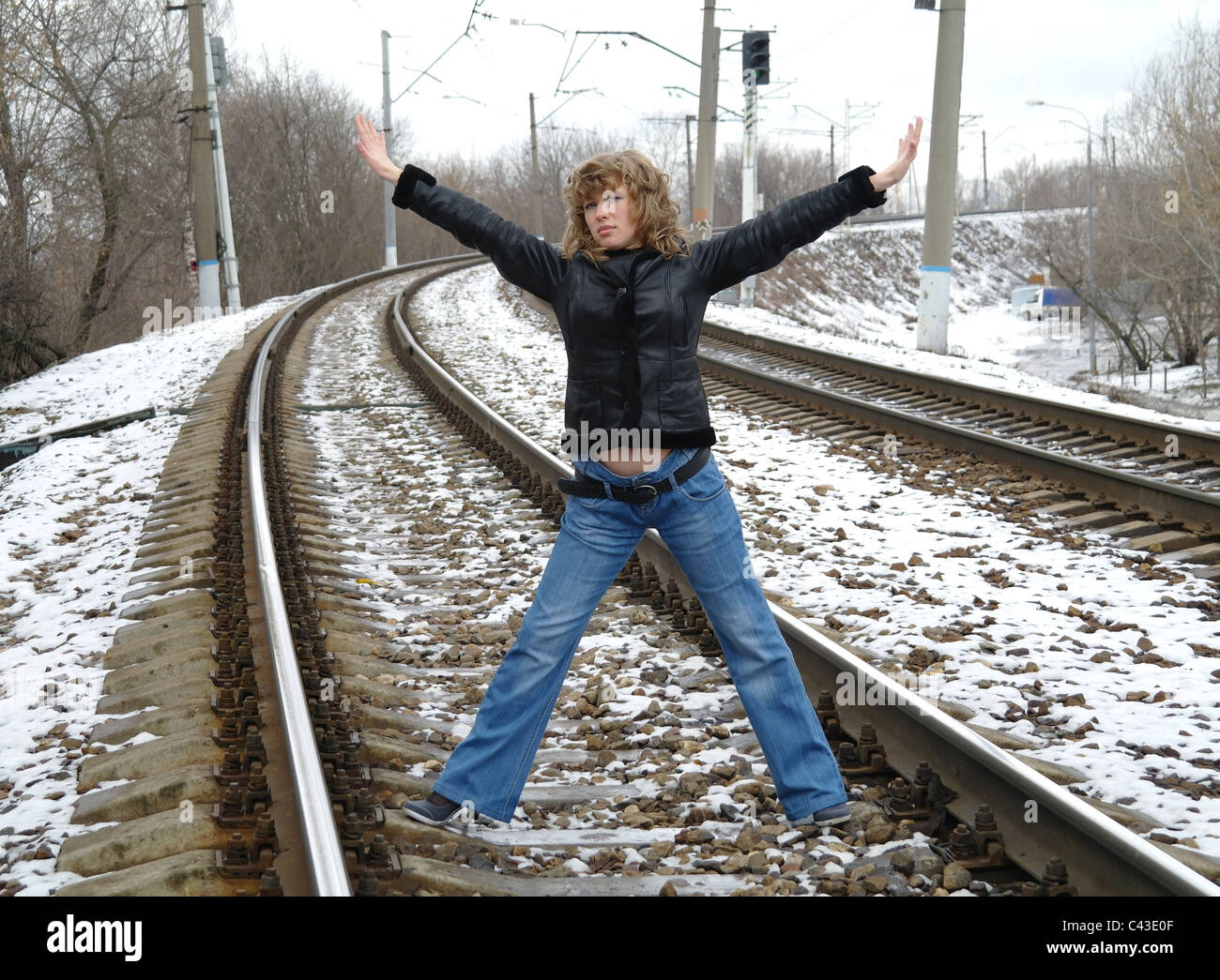 The girl on rails in the winter, Moscow, Russia Stock Photo