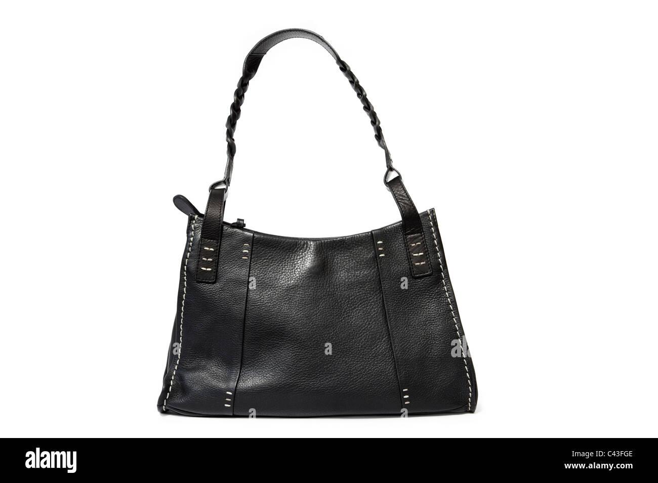 Women's black leather Radley handbag purse bag with shoulder strap on a white background - Stock Image
