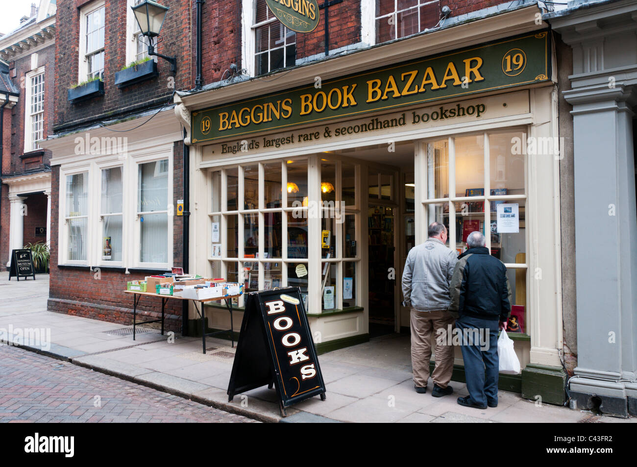 Baggins Book Bazaar in Rochester High Street describes itself as England's largest rare and secondhand bookshop. - Stock Image
