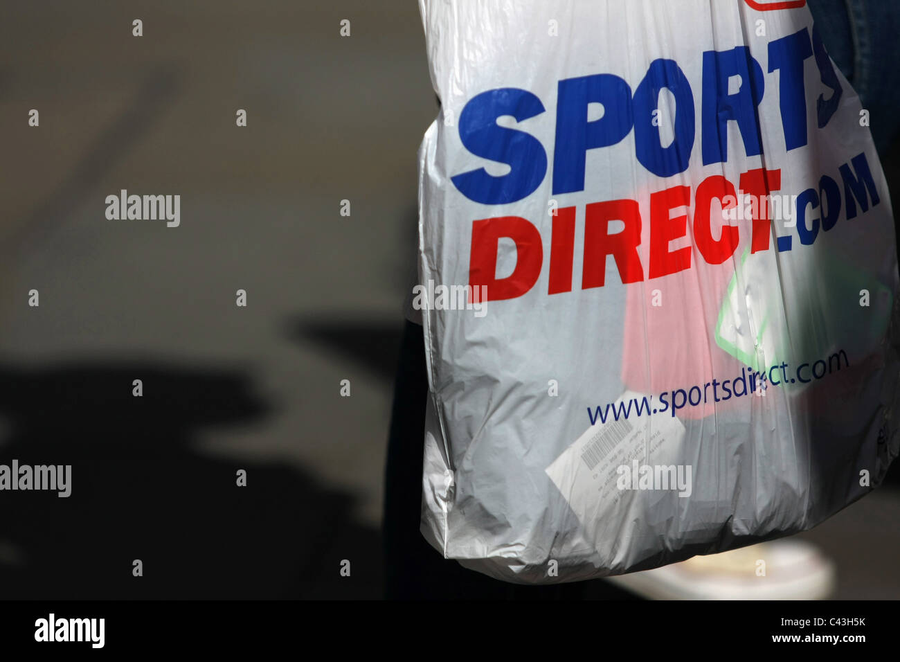 8a6618973899 A Sport Direct plastic shopping bag being carried in London Stock ...