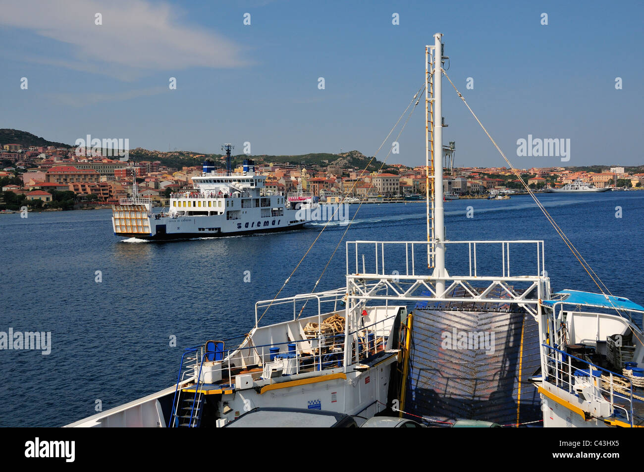 Ferries to and from Palau to La Maddalena (in view), Sardinia, Italy Stock Photo