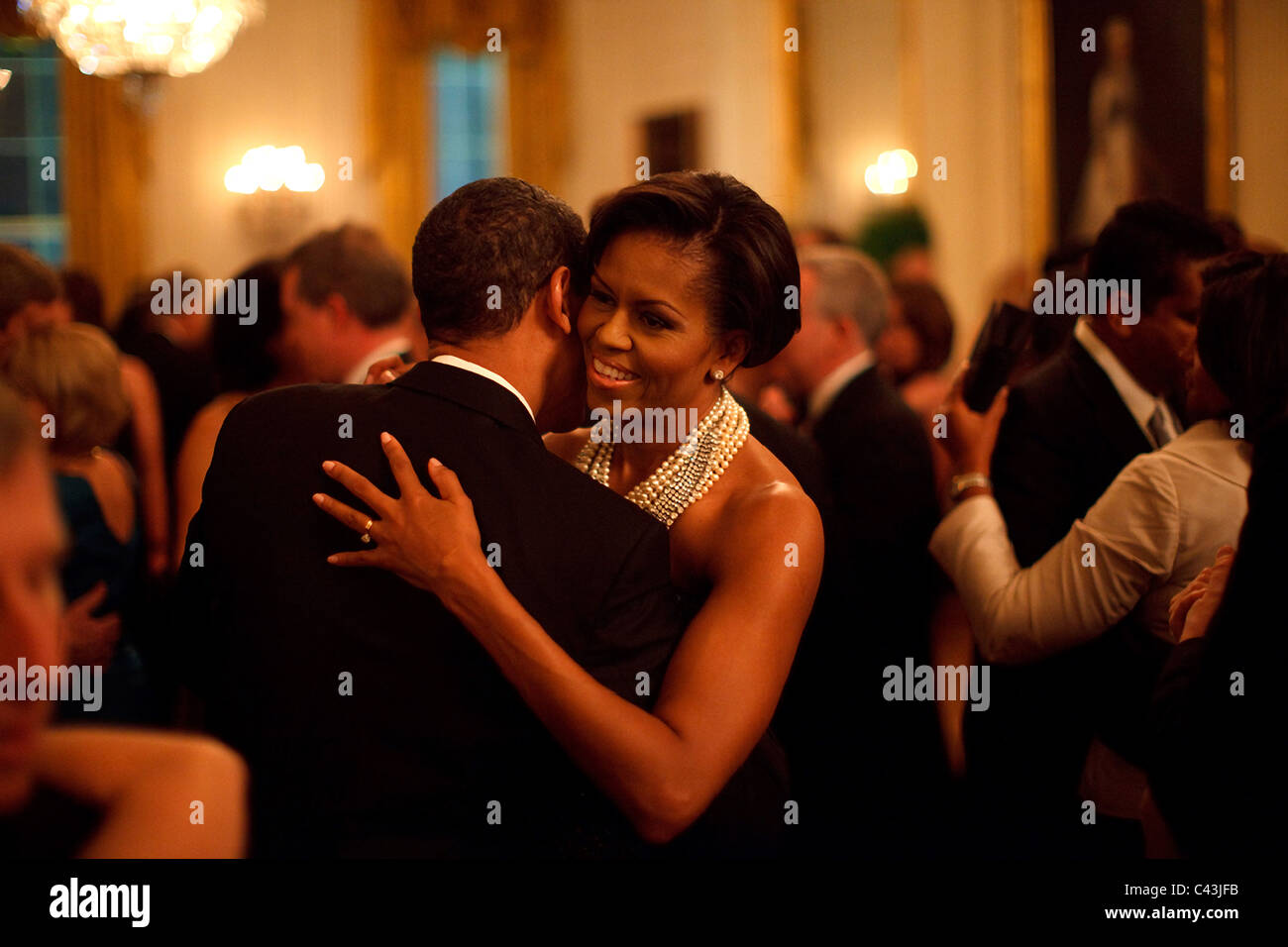 President Barack Obama and First Lady Michelle Obama dance while the band Earth, Wind and Fire performs at the Governors - Stock Image