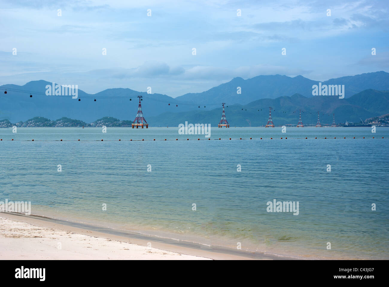 Cable car crossing the sea - Stock Image