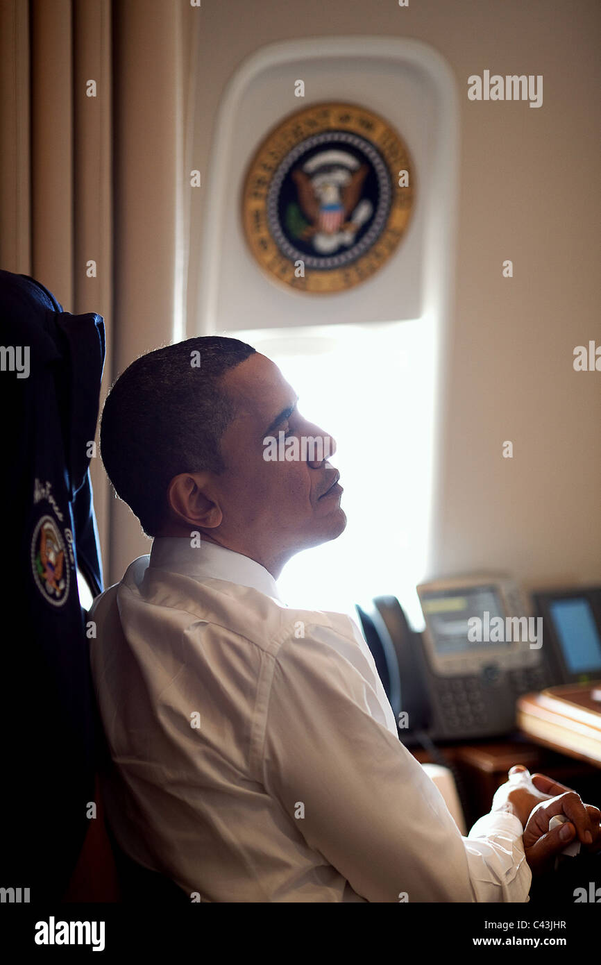 President Barack Obama listens during a meeting with Members of Congress aboard Air Force One - Stock Image