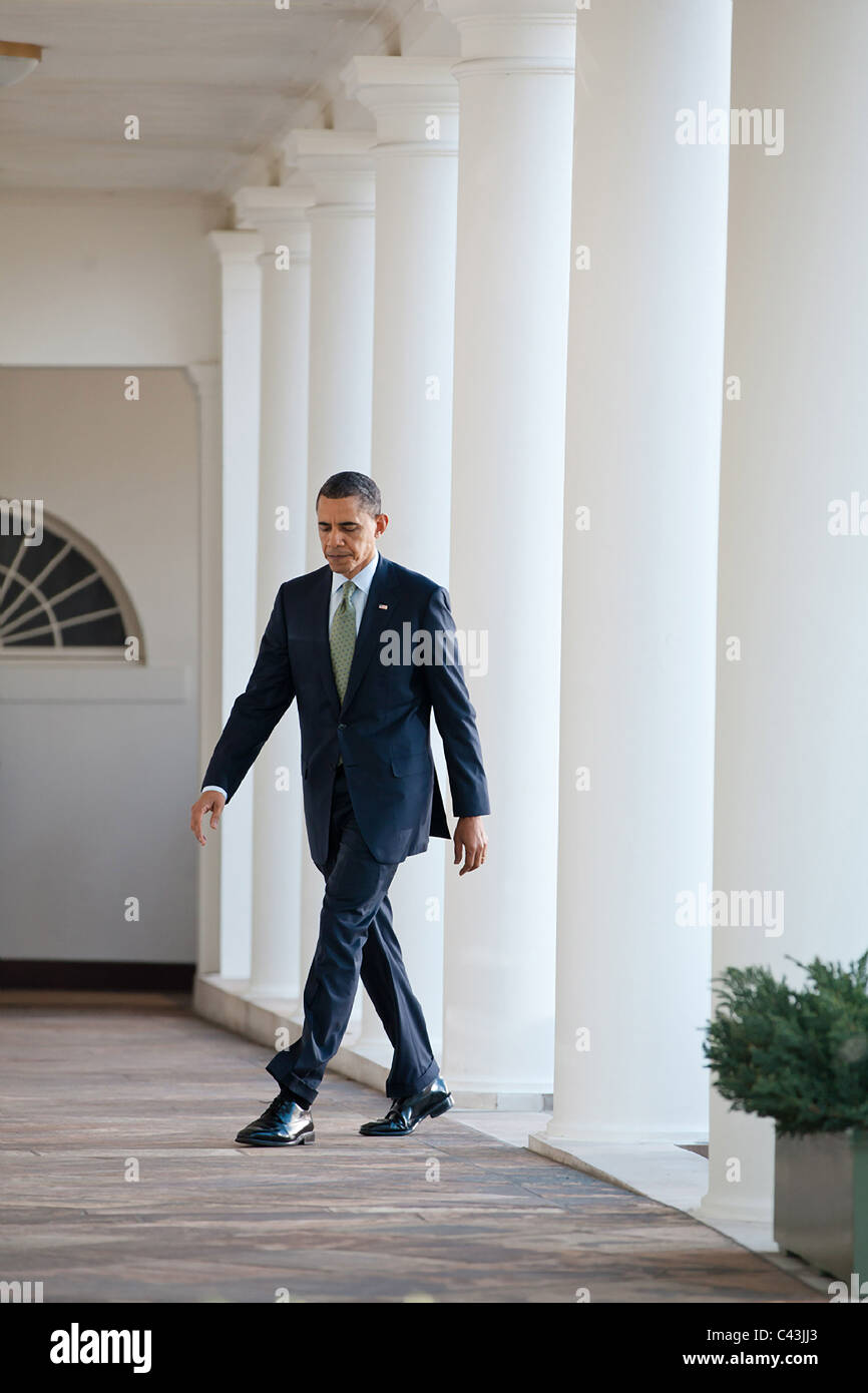 President Barack Obama walks on the Colonnade of the White House - Stock Image