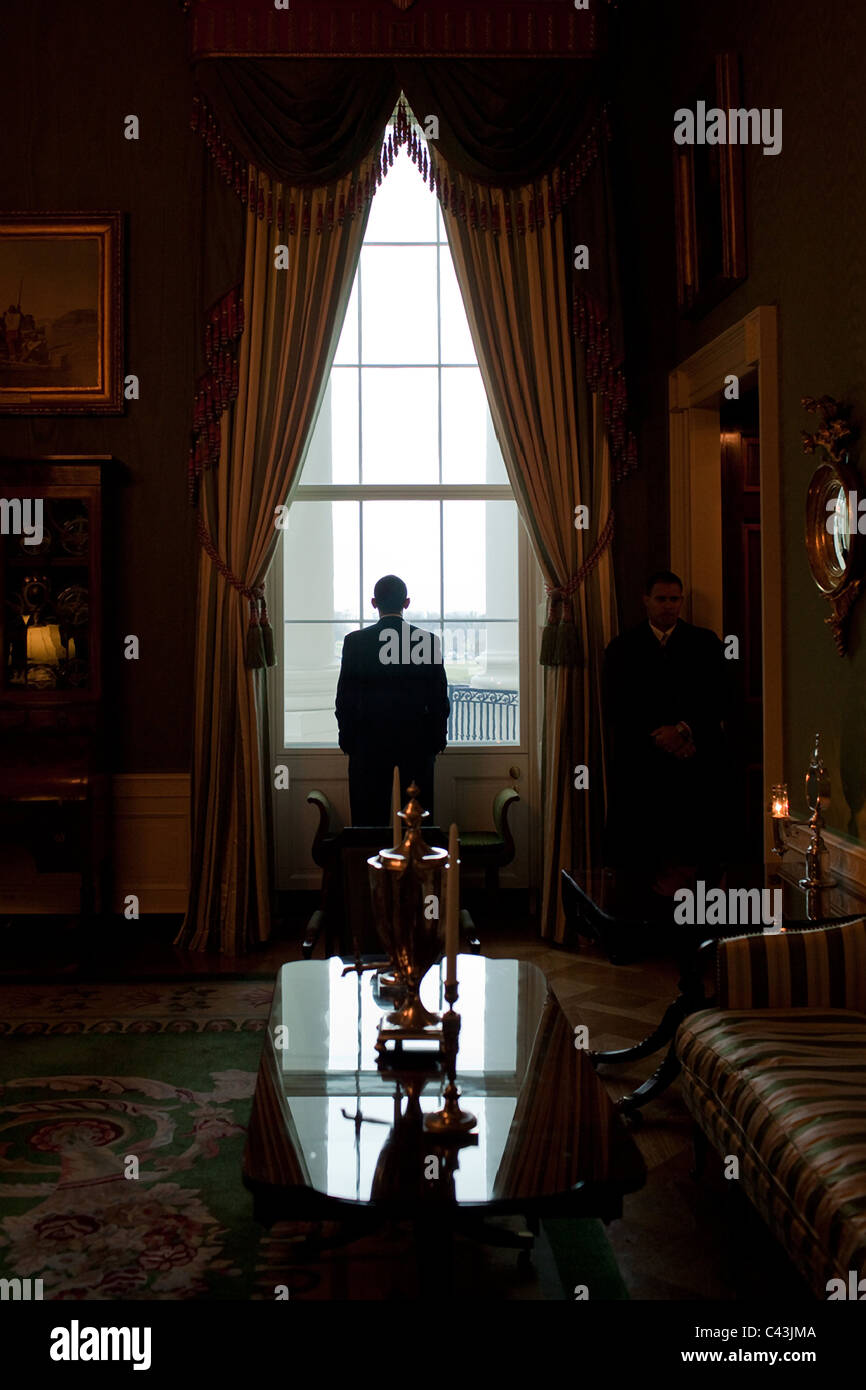 President Barack Obama looks out the Green Room - Stock Image