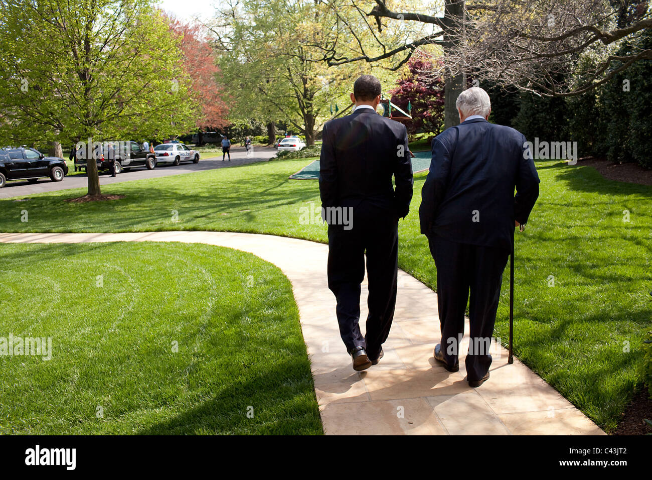 President Barack Obama and Senator Ted Kennedy walk on the grounds of the White House - Stock Image