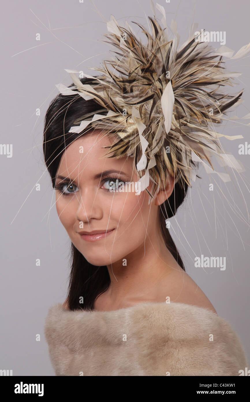 Woman wearing designer hat - Stock Image