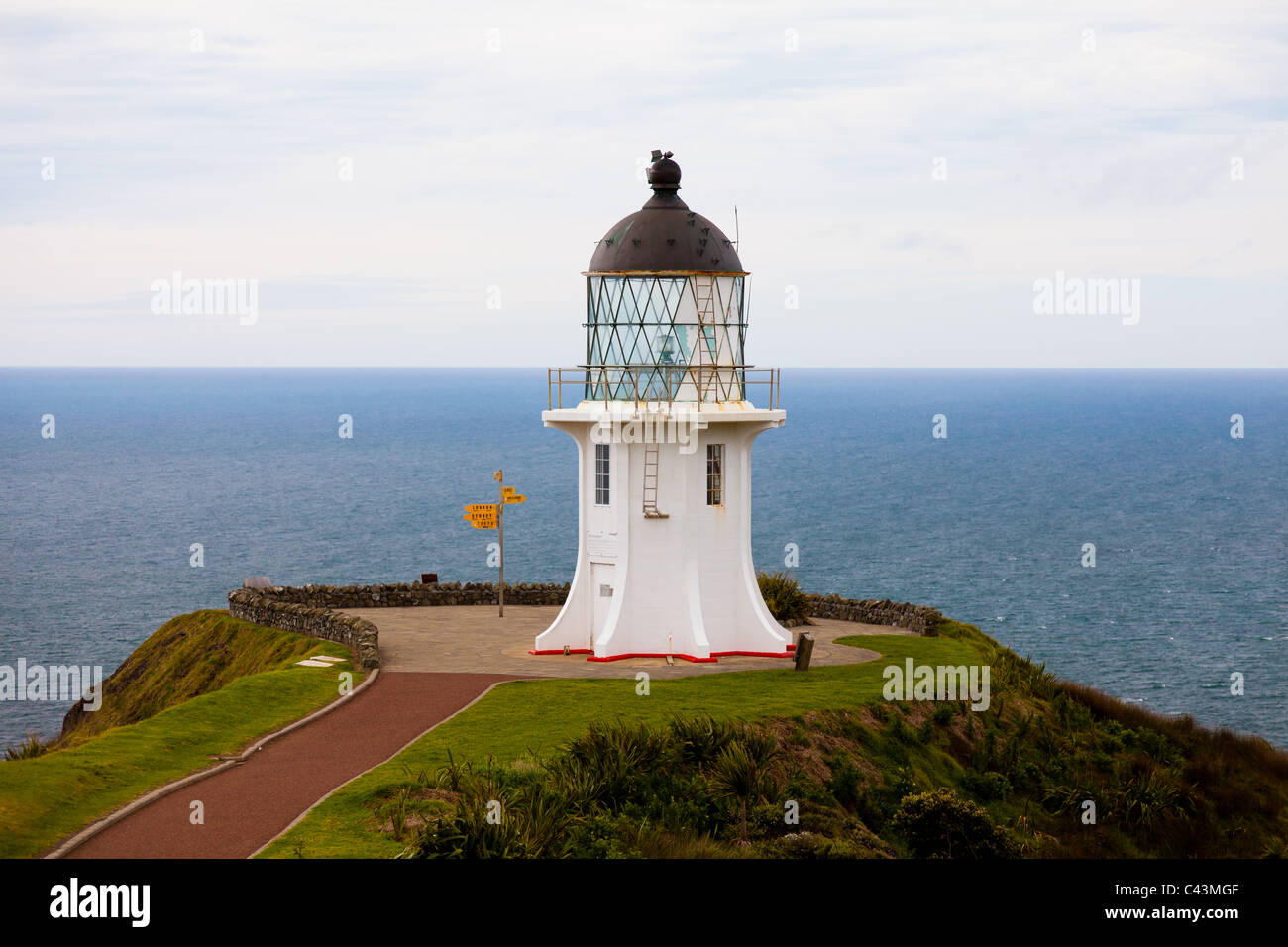 The lighthouse at Cape Reinga, the northest point of New Zealand on the Aupouri peninsula - Stock Image