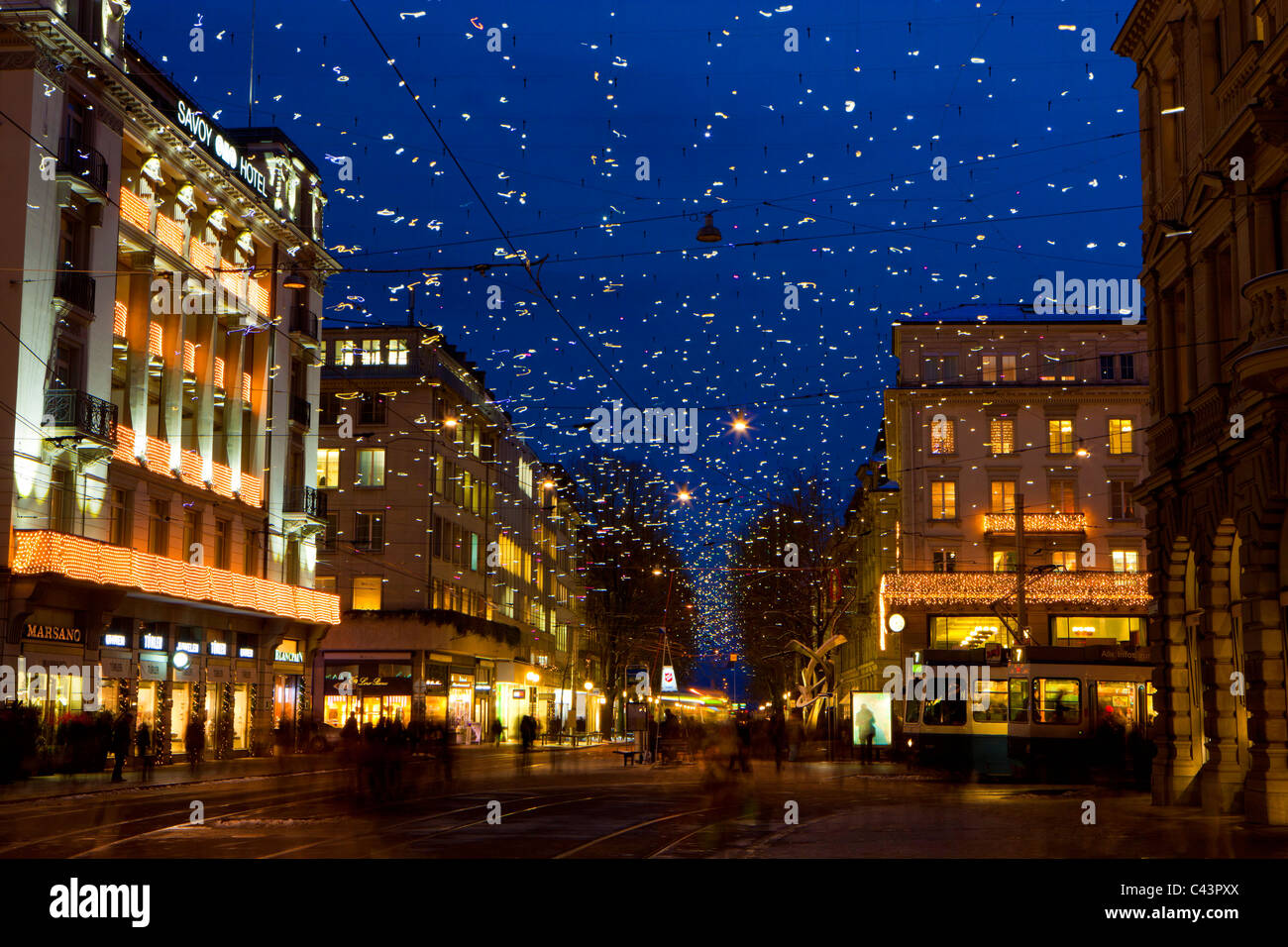 Zurich, Switzerland, canton Zurich, town, city, street, Bahnhofstrasse, houses, homes, dusk, lights, illumination, - Stock Image