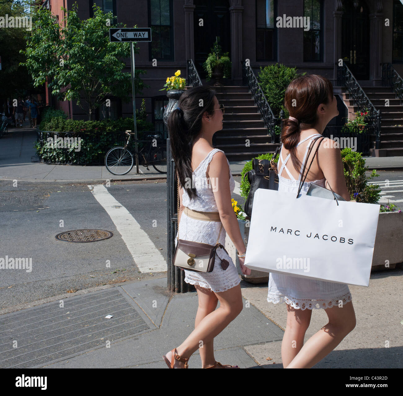 4f72e41853043 Shoppers leave a Marc Jacobs store on Bleecker Street in Greenwich Village  in New York -