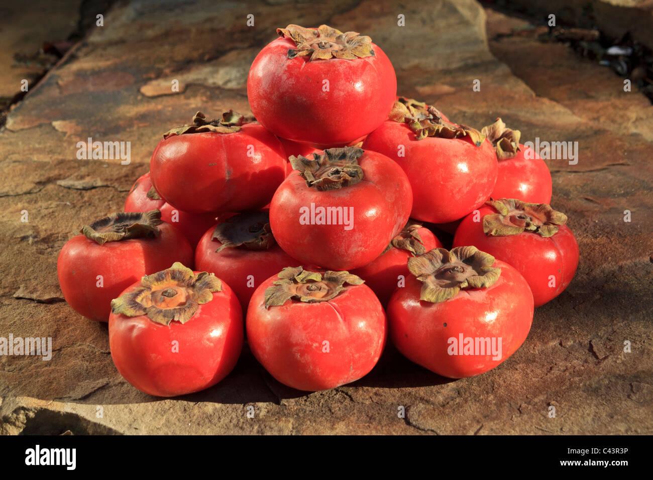 Diospyros, Ebenaceae, edible fruit, fruit, fruits, Fuyu, health, Japanese persimmons, kaki, persimmons - Stock Image
