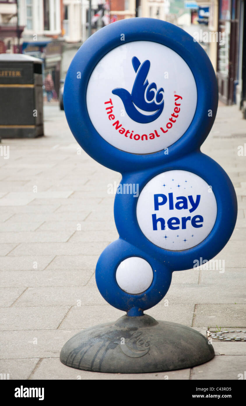 National Lottery sign in street. - Stock Image