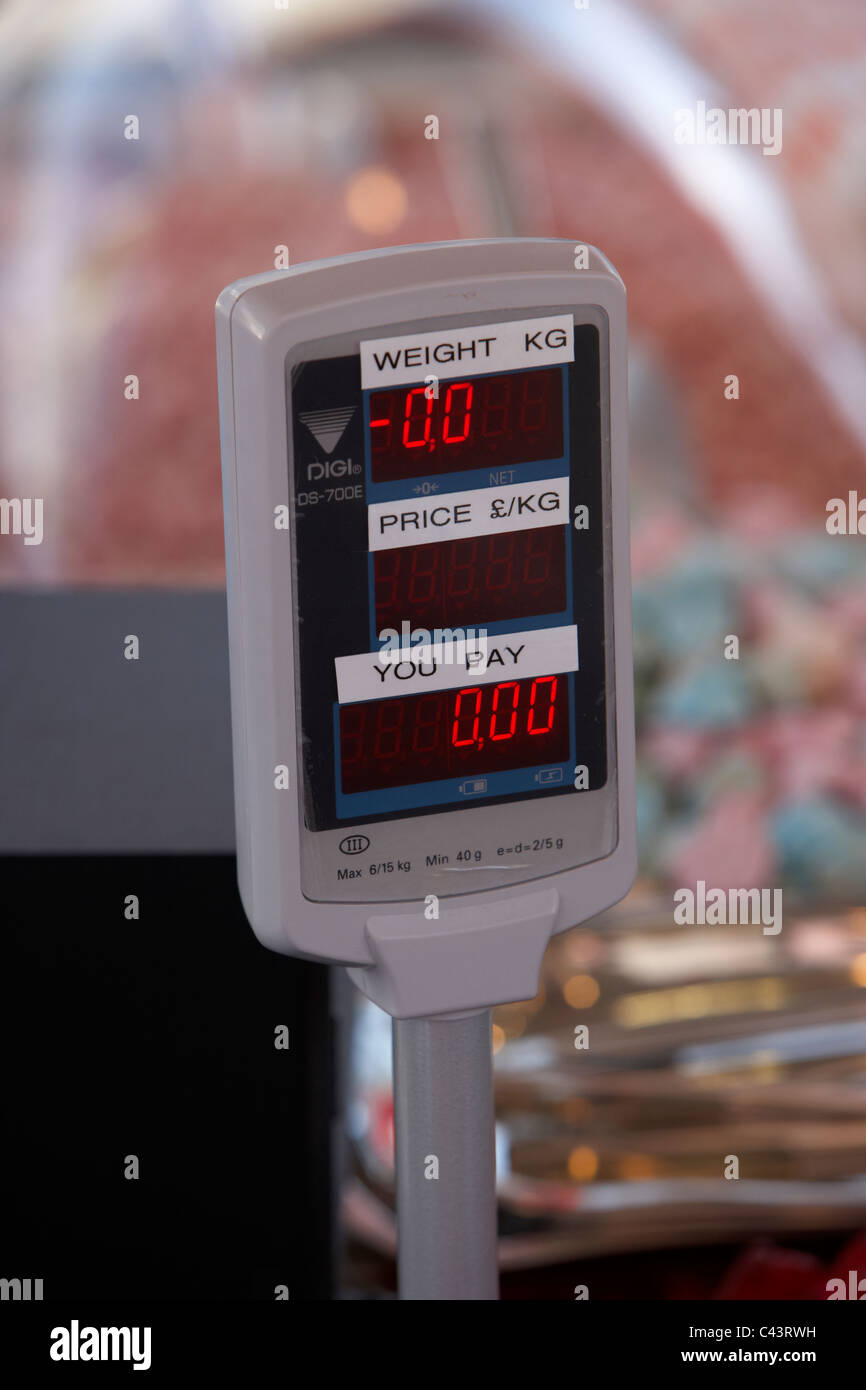 digital weighing scales on a stall in a market - Stock Image