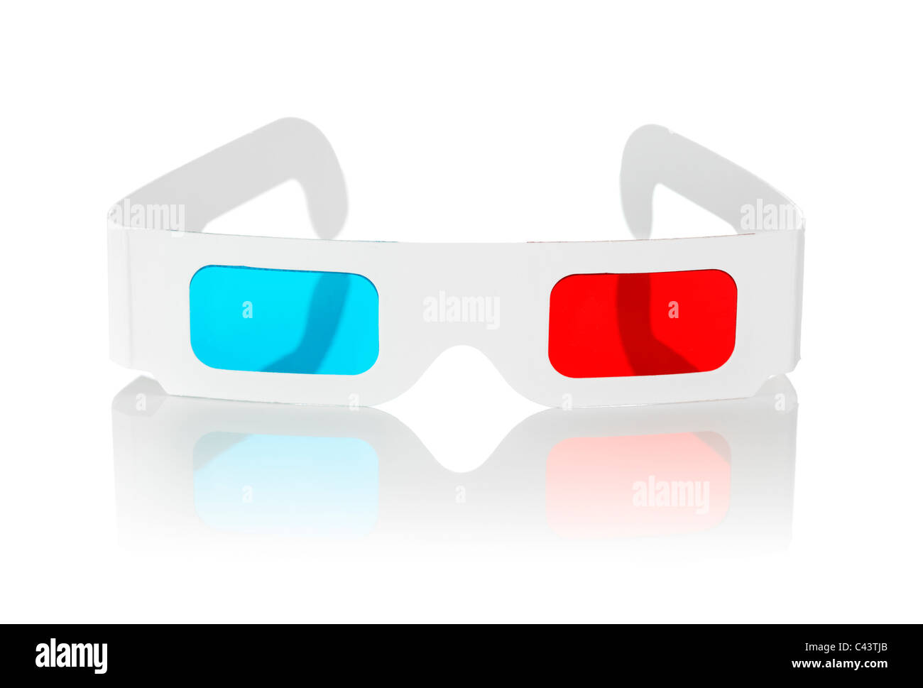 Disposable cheap cardboard 3D glasses with red and cyan lenses isolated on white. - Stock Image