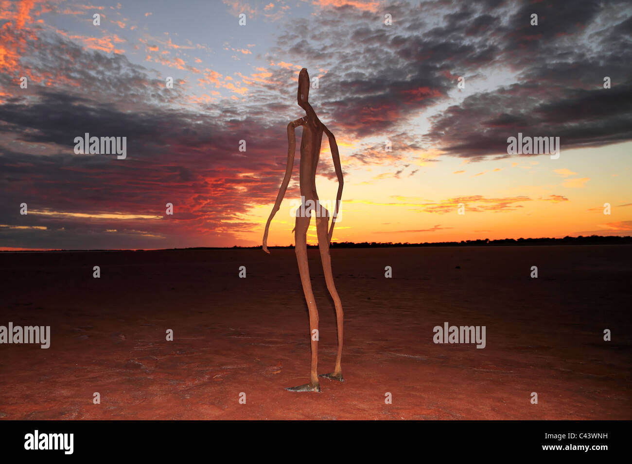 Sculpture by Antony Gormley, Inside Australia exhibition, on Lake Ballard at sunrise, Western Australia Stock Photo