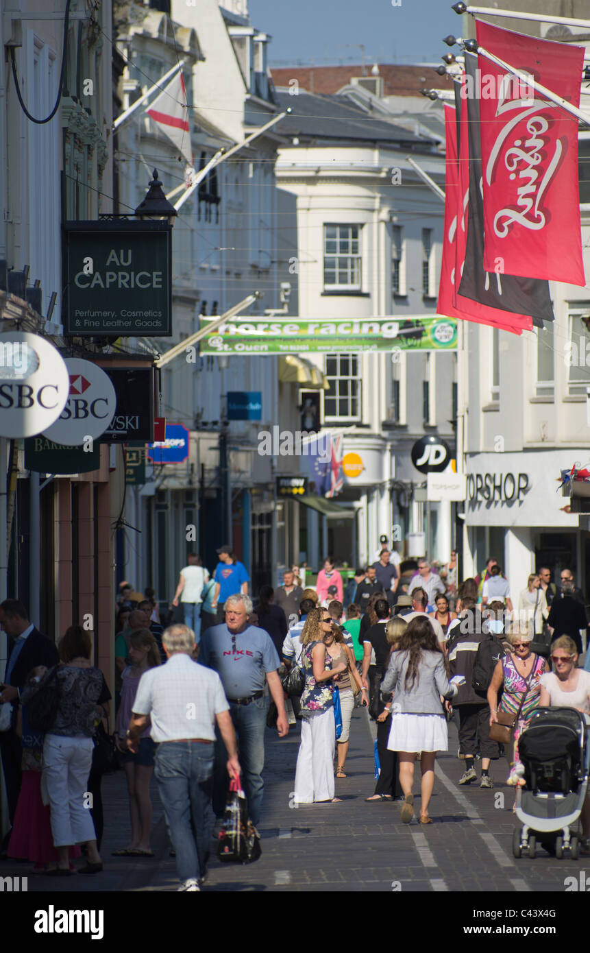 Kinfg Street, St Helier, Jersey, Channel Islands, thronging with shoppers on a warm summers day. - Stock Image