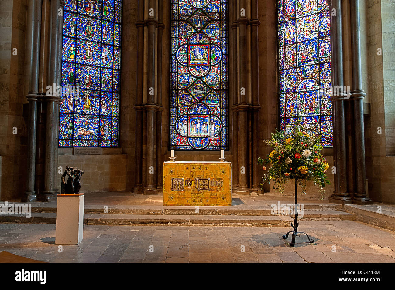 England, Canterbury Cathedral. Interior. Altar in the trinity chapel, with three stained-glass windows behind. HDR - Stock Image