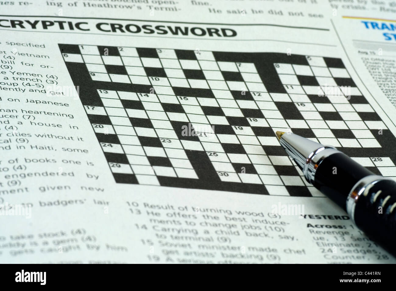 Pen On Top Of The Crossword Puzzle Section A Newspaper