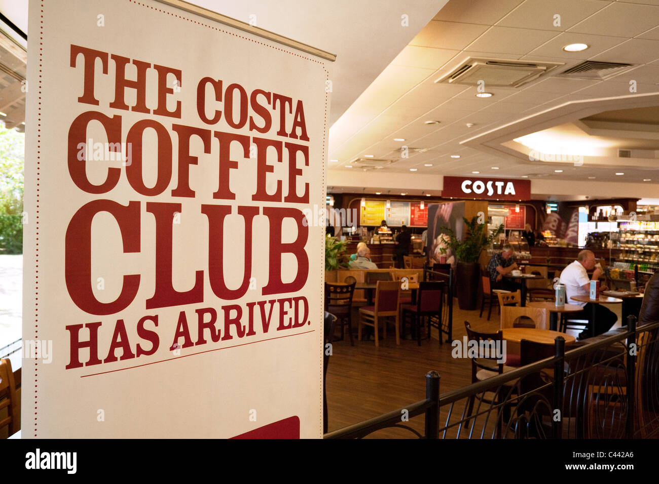 Sign advertising the Costa Coffee club, Costa coffee, Clacket Lane motorway service station, M25, Surrey UK - Stock Image