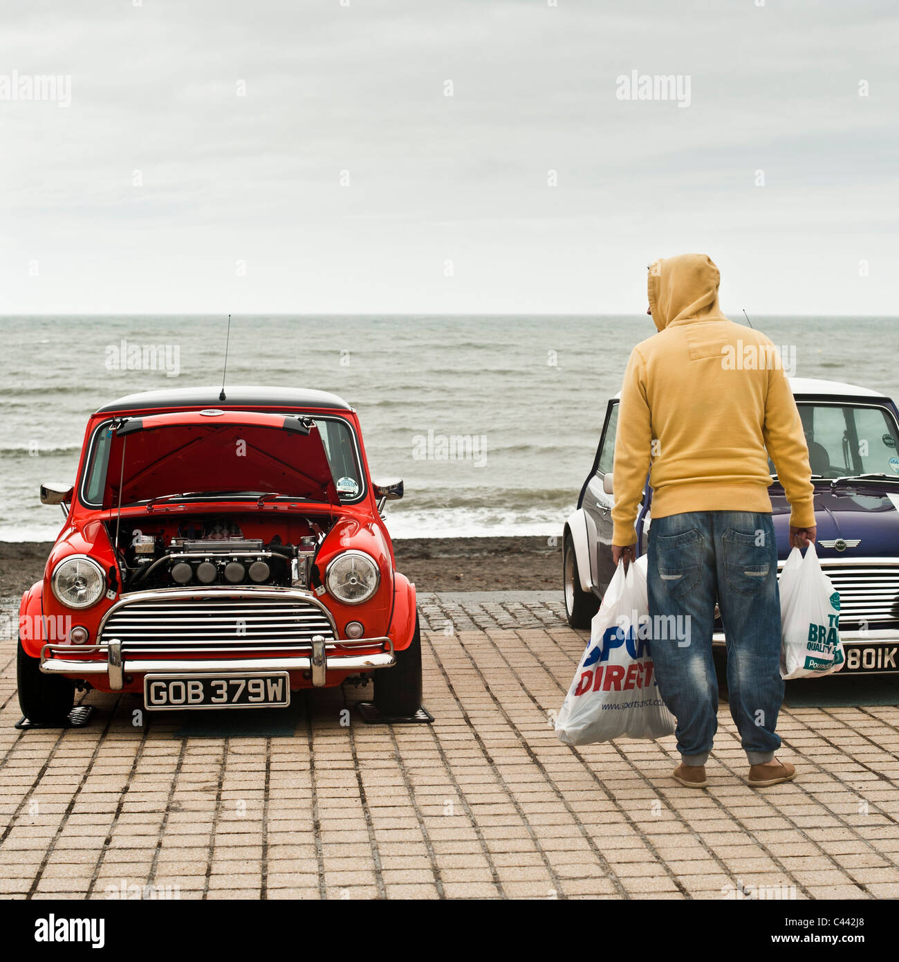Whitsun Bank Holiday Weekend - Mini car owner rally on the promenade Aberystwyth Wales UK - Stock Image