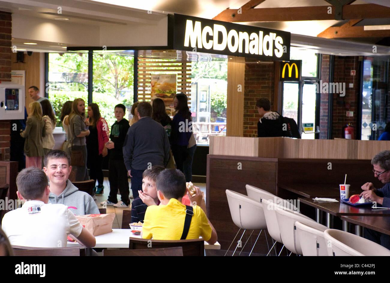 People at McDonalds, Clacket Lane motorway services, M25 in Surrey, UK - Stock Image
