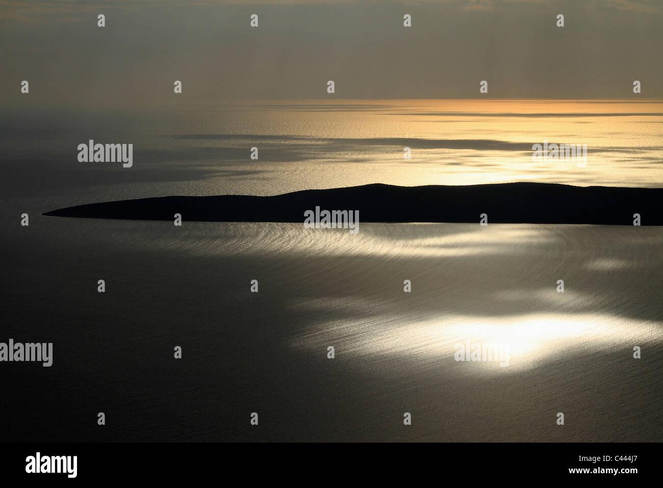 Sunrise on the Adriatic Sea near Unije, Croatia - Stock Image