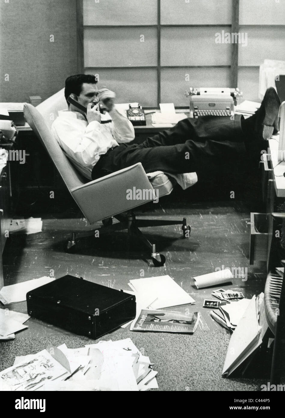 HUGH HEFNER founder of Playboy magazine in his office about 1965 - Stock Image