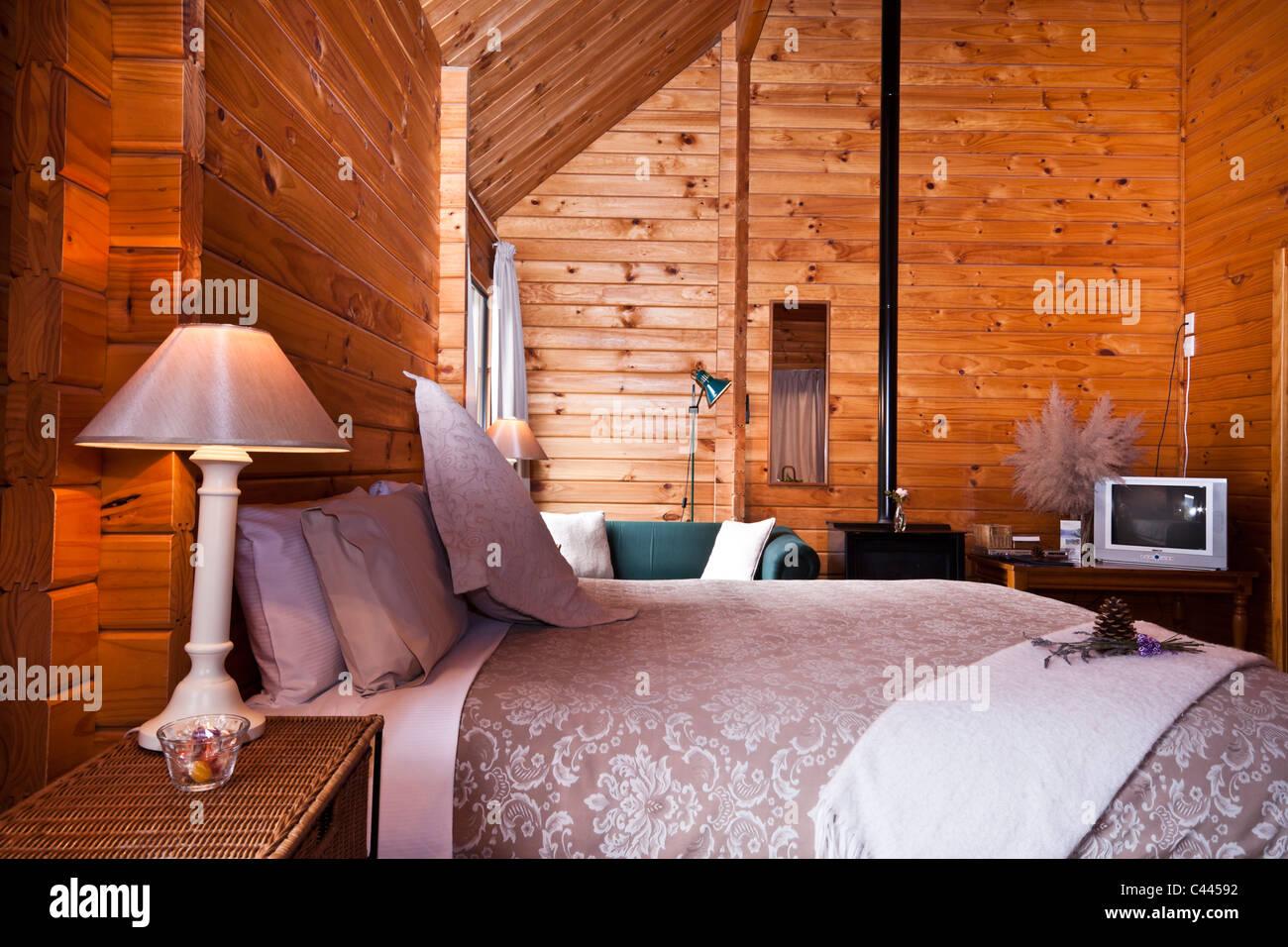 Nice warm interior of mountain lodge apartment. Fox Glacier Lodge, Fox Glacier, West Coast, South Island, New Zealand. Stock Photo