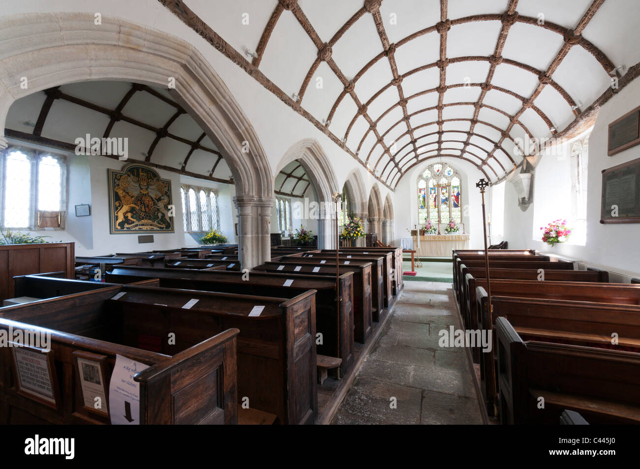 The interior of St Sampson's Church in the Cornish village of Golant, showing the wagon vaulting of the aisles. - Stock Image