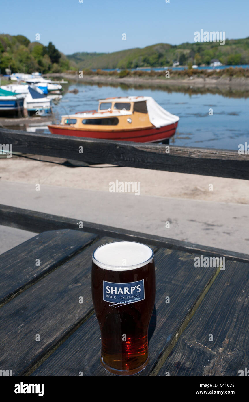 A pint of Doom Bar bitter from Sharp's brewery of Rock outside the Fisherman's Arms Inn, Golant, Cornwall. - Stock Image