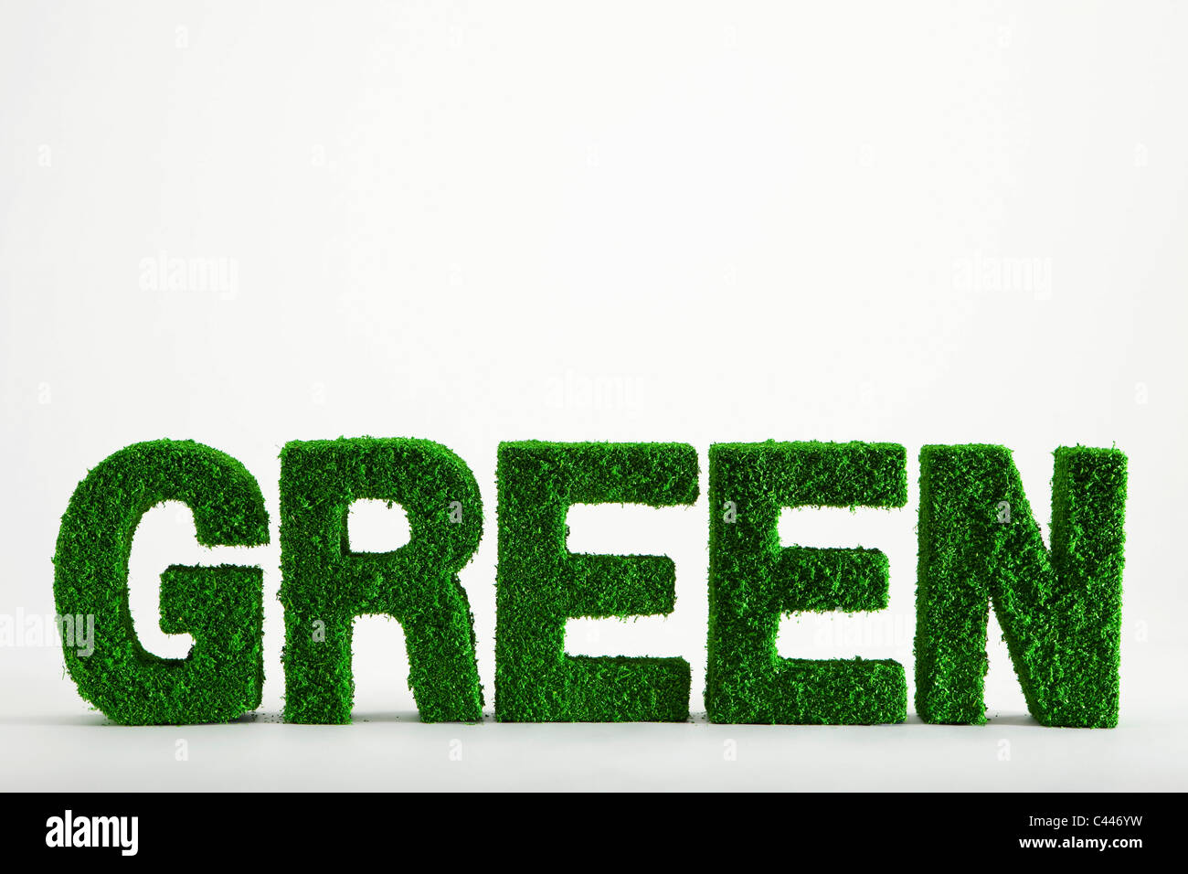 The word Green made from grass covered objects - Stock Image