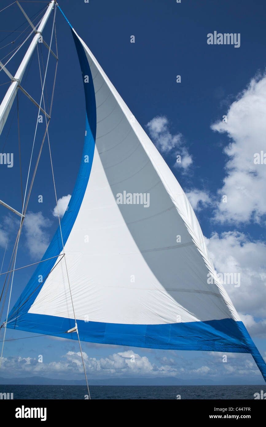 Sail and mast of a yacht - Stock Image