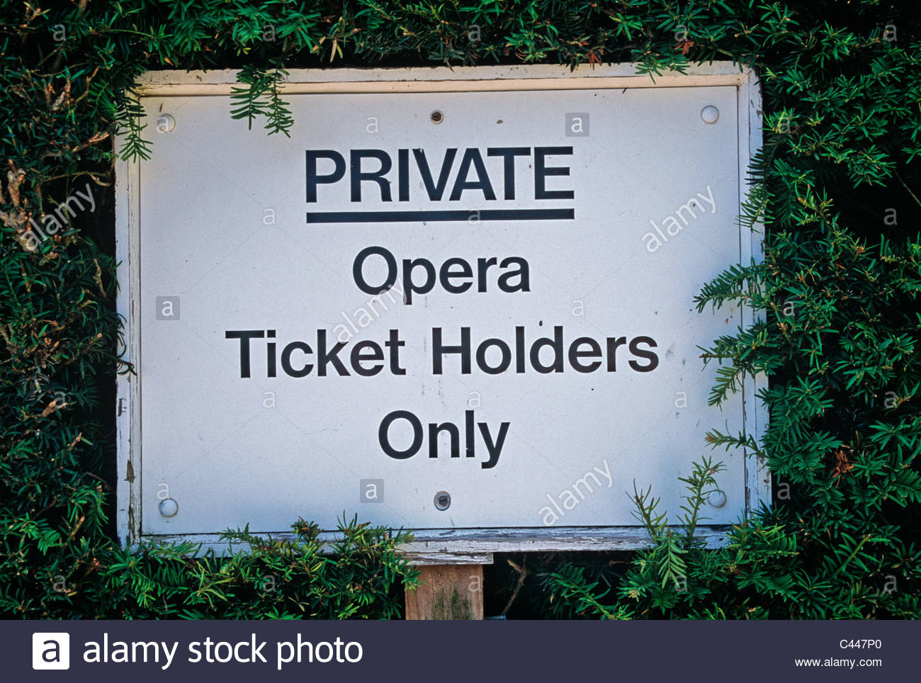 A sign in the gardens at Glyndebourne at the entrance to the grounds of the Opera House. Sussex - Stock Image