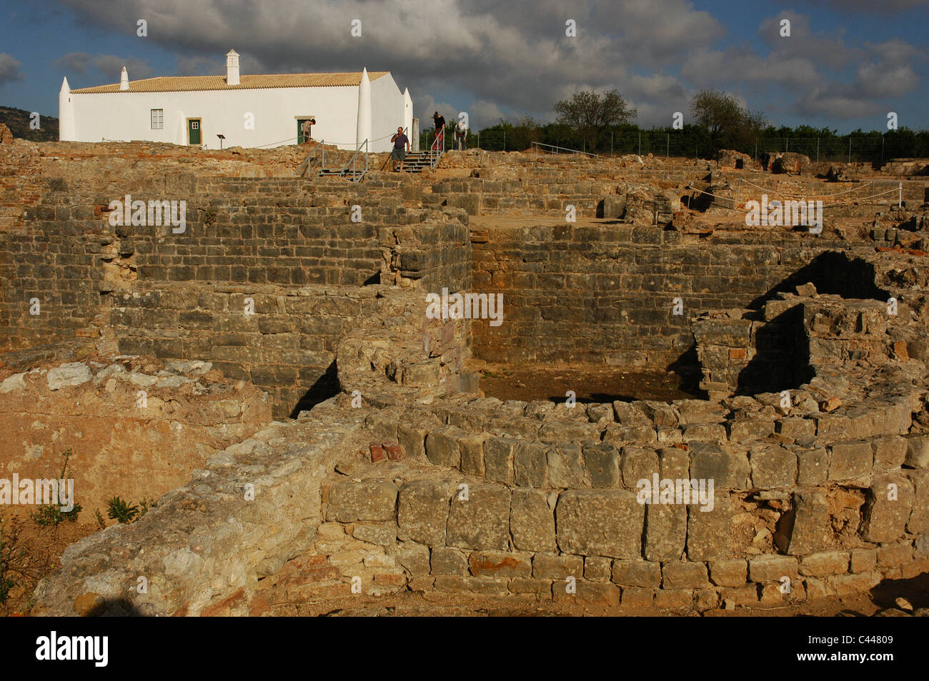 Ruins of Milreu. Roman Villa (1st - 4th century A.D.). In the foreground, the Baths next to a 16th century house. Stock Photo