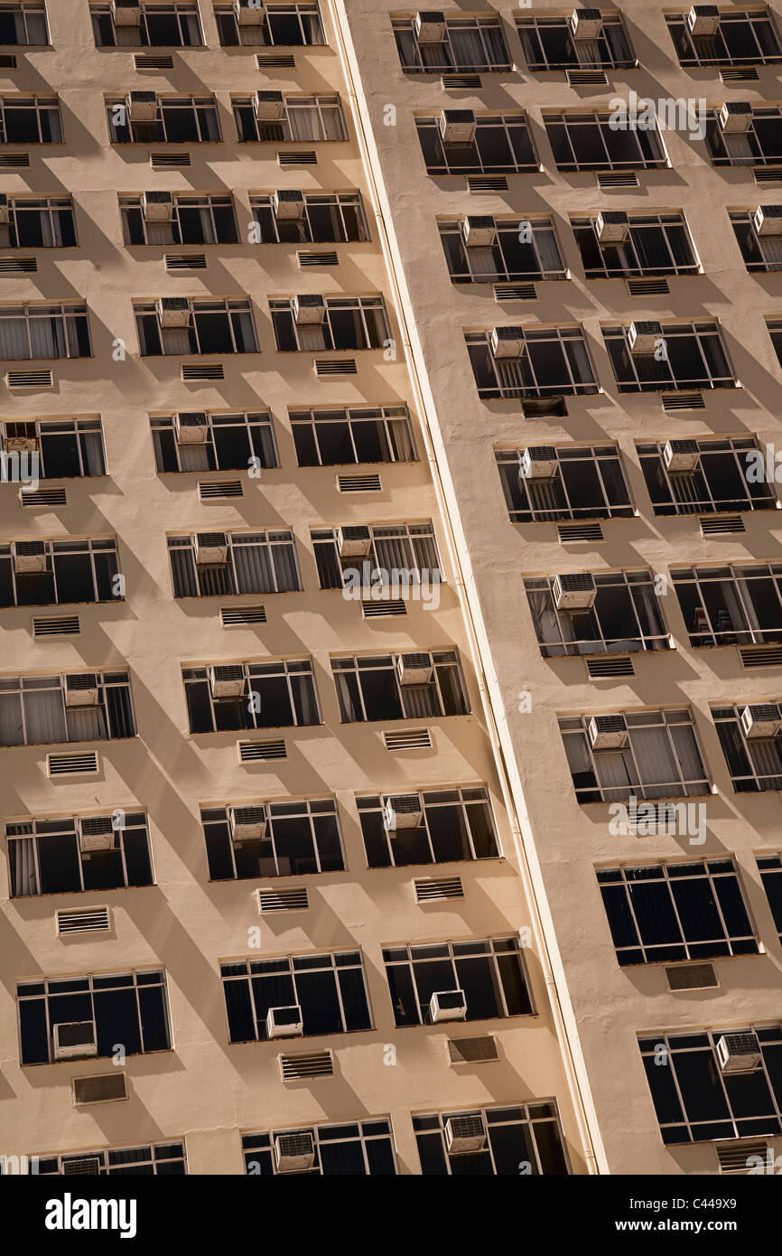 Tower block of flats with air conditioners on each window - Stock Image