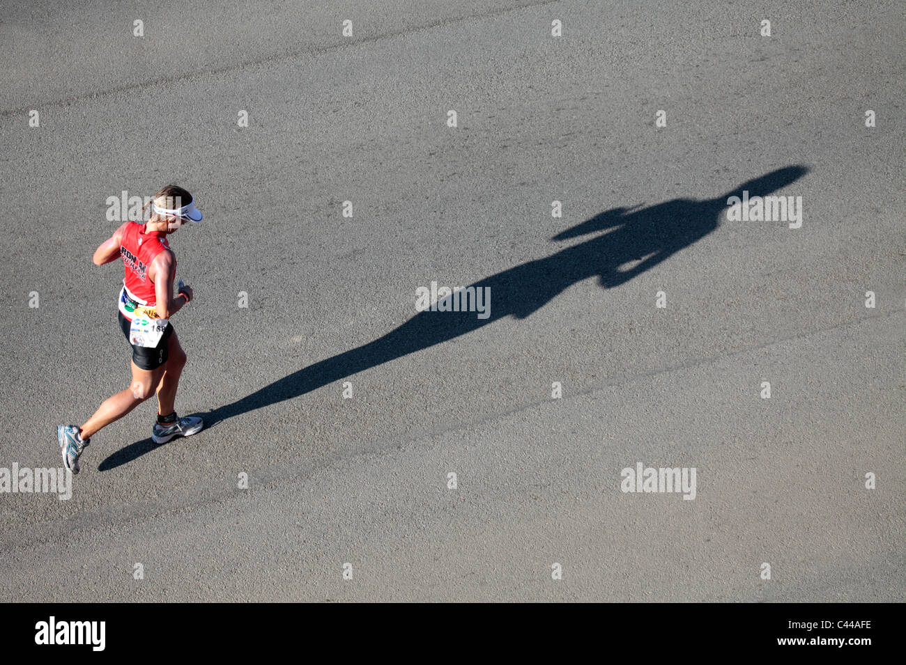 Female Competitor in the Iron Man Triathlon Competition, Summerstrand, Port Elizabeth, Eastern Cape, South Africa - Stock Image