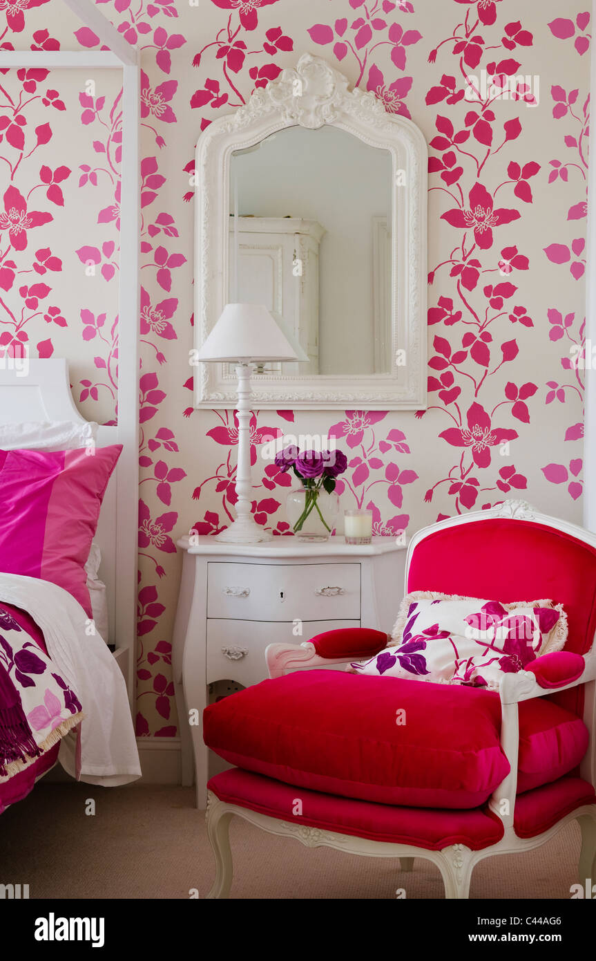 Red Velvet Armchair In Bedroom With Fourposter Bed And Designers Guild  Floral Pink Wallpaper