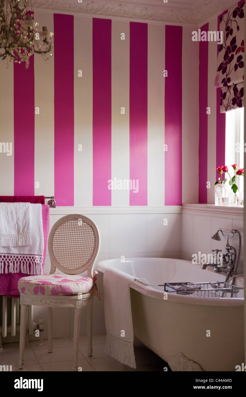 Freestanding Bath Tub In Bathroom With Striped Wallpaper And Floral Blinds