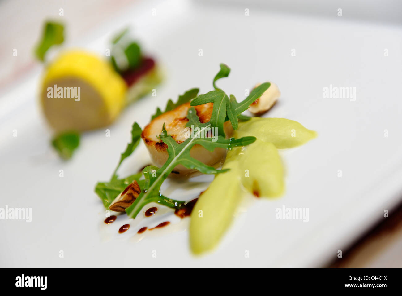 A gastronomic scallop dishes with apples - Stock Image