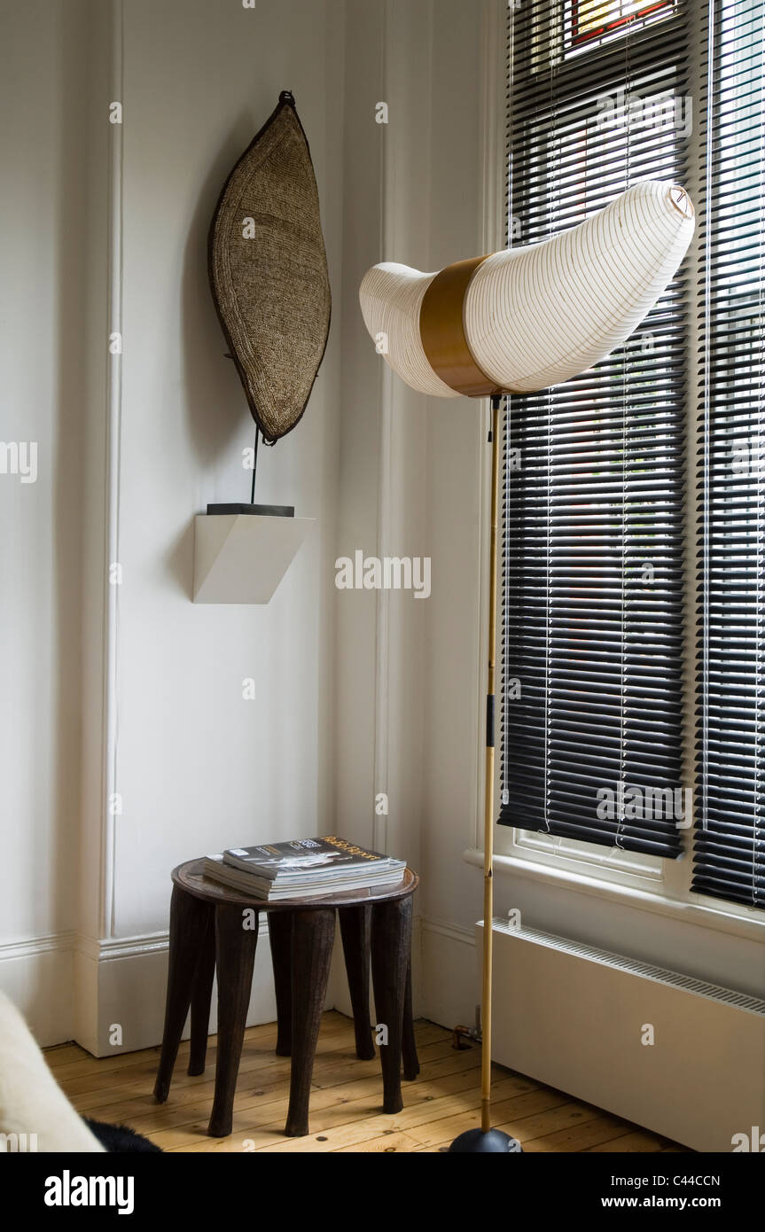 Isamu Noguchi Akari Lamp By Window With Blinds And Ethnic Shield
