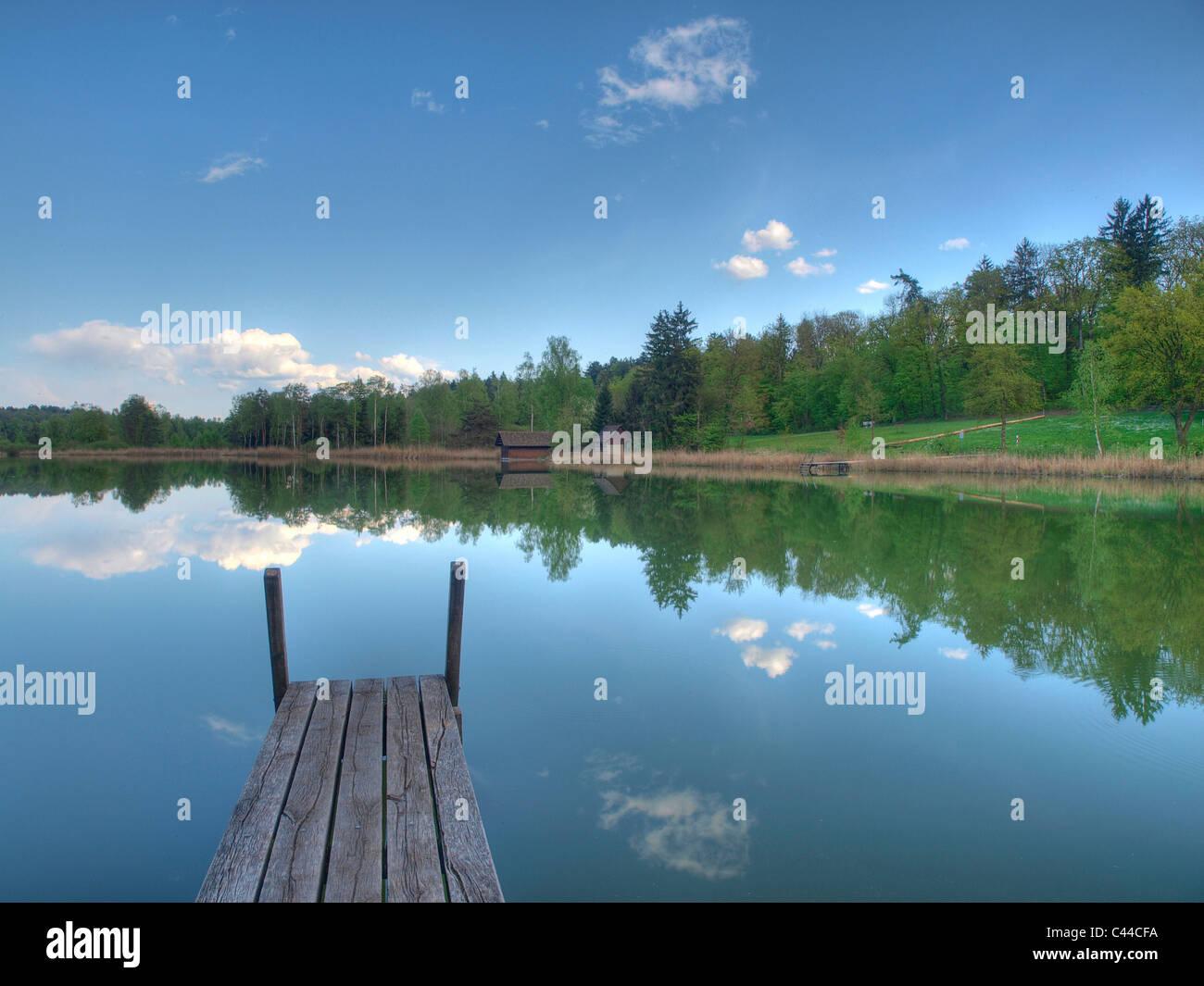 Blue, spring, himmel, idyl, footbridge, lake, wood, forest, water, clouds, canton Zurich, Switzerland, Husemersee, - Stock Image
