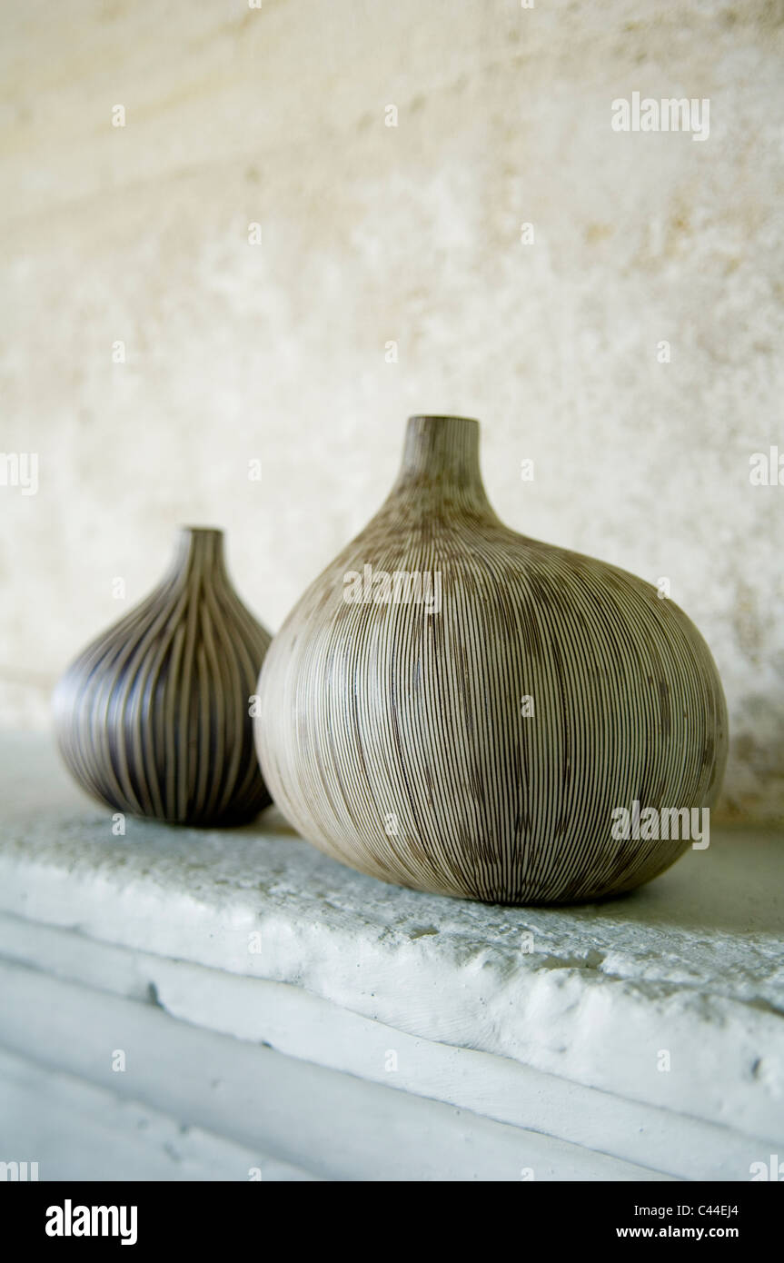 Close up of pair of gourds on a stone mantelpiece - Stock Image