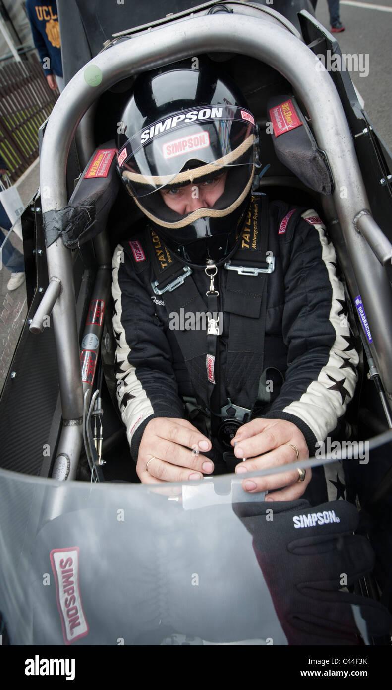 Close up of racing driver in a racing car cockpit - Stock Image