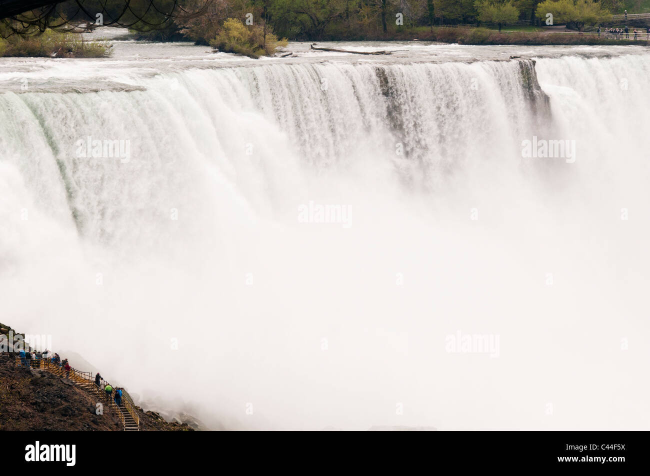 Lower catwalks at Prospect Point offer a unique perspective and scale of the American Falls. - Stock Image