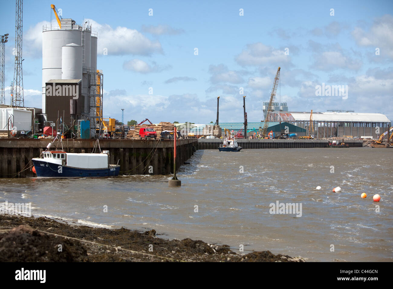 Montrose Harbour new renovated quayside and recent reconstruction of Quayside.New Grain silos being constructed - Stock Image