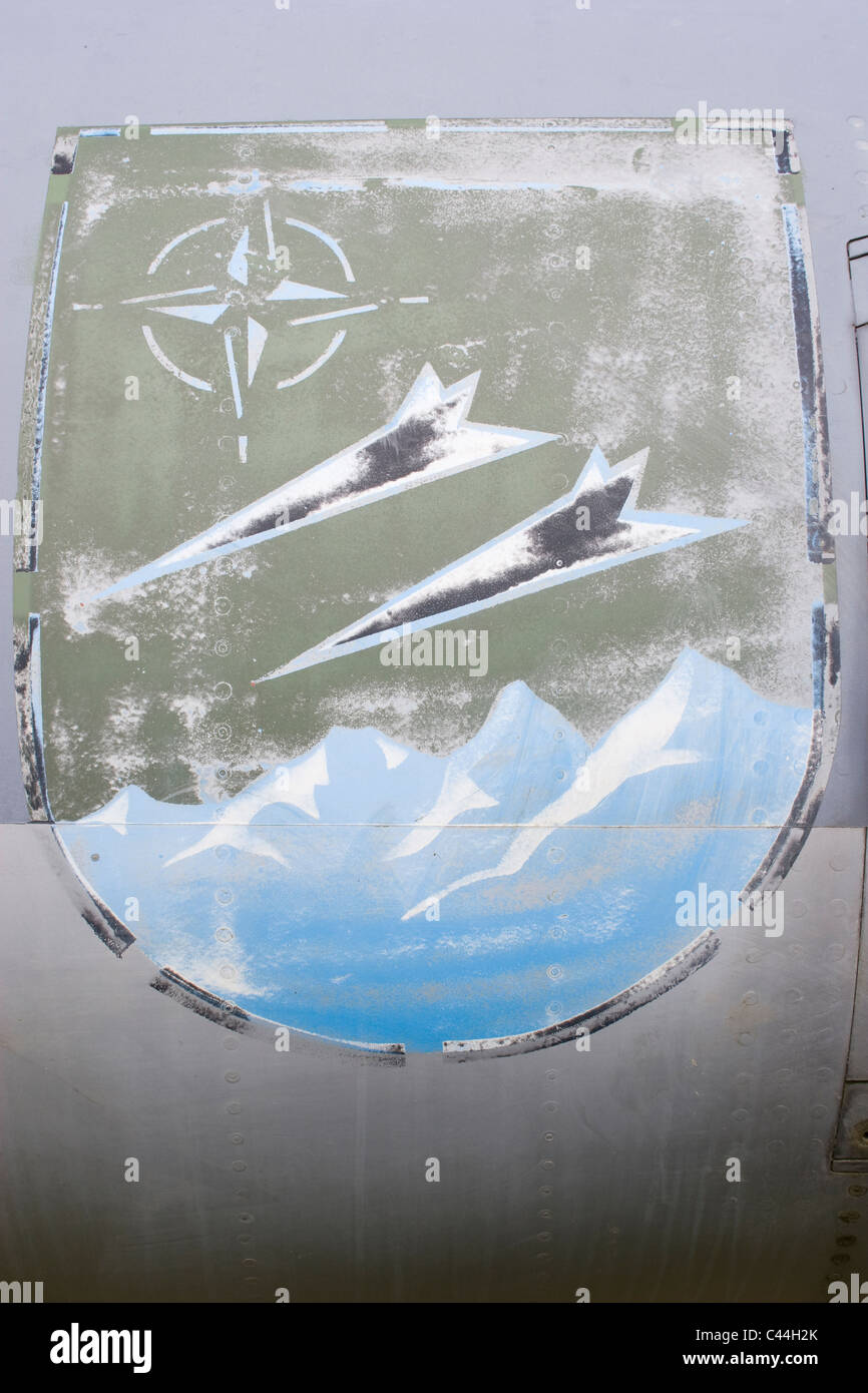 badge emblem fade aircraft squadron fighter command jet body fuselage weather rub off close up compass black darts - Stock Image