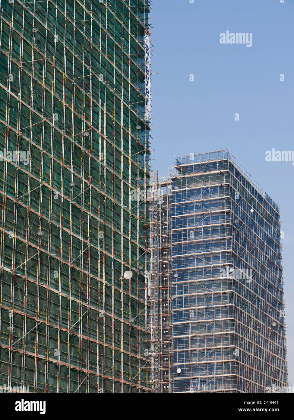 Residential tower blocks covered in scaffolding near Shepherd's Bush London UK - Stock Image